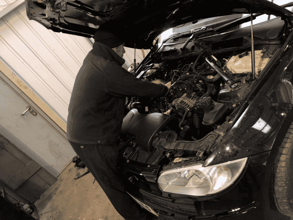 A Mechanic completing repair work on a car at Michael Wicks Garage
