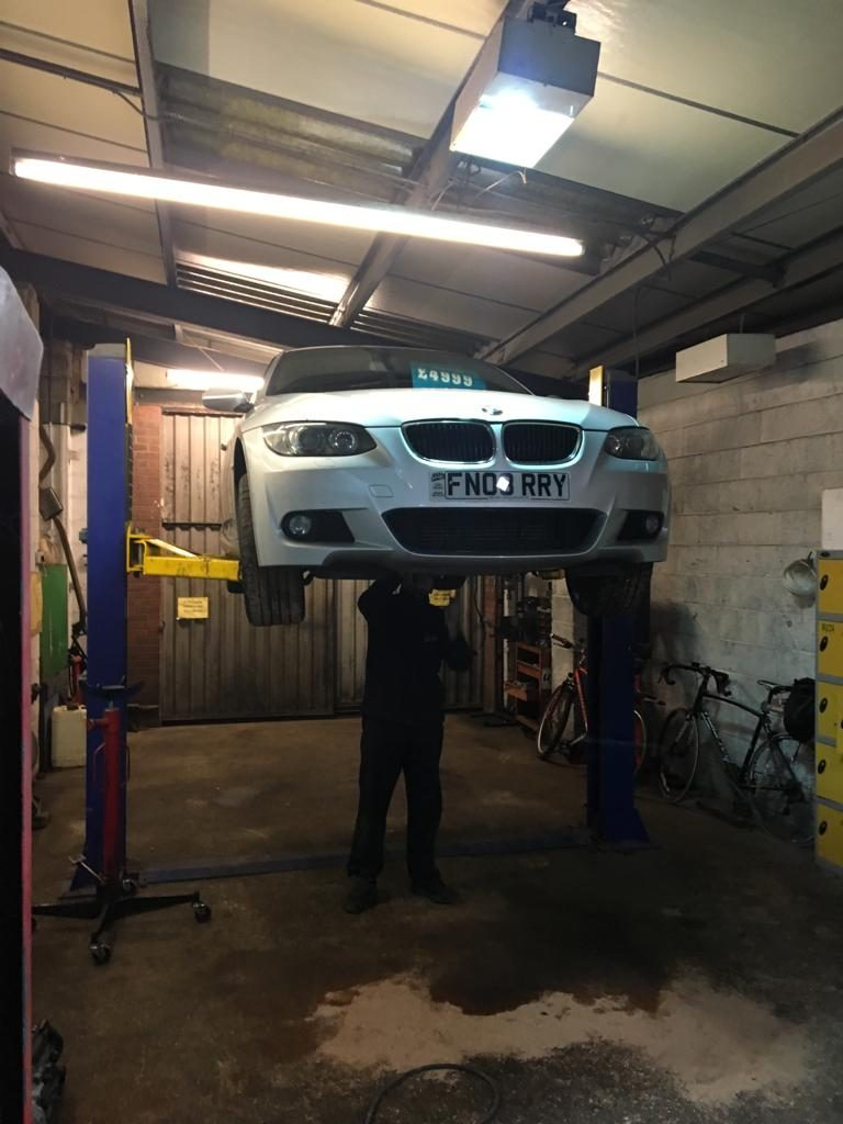 Ryan working on the underbody of a BMW at Michael Wicks Garage in Wisbech